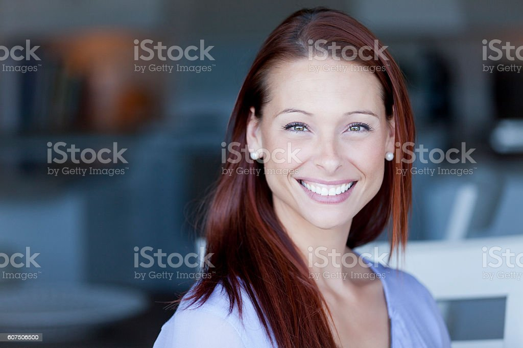 Smiling Woman At Home Looking At The Camera stock photo
