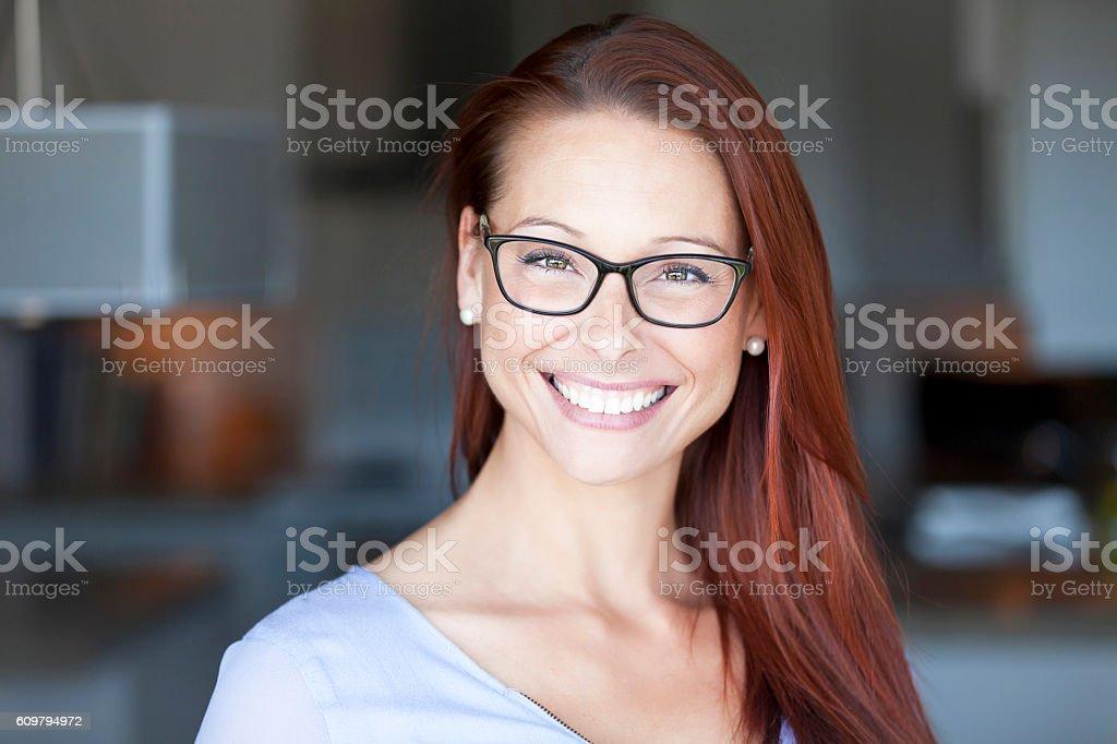 Smiling Woman At Home Looking At The Camera stock photo