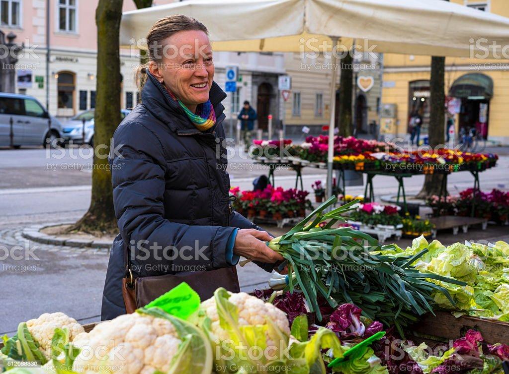 Smiling Woman at vegetable market in Ljubljana, Slovenia stock photo