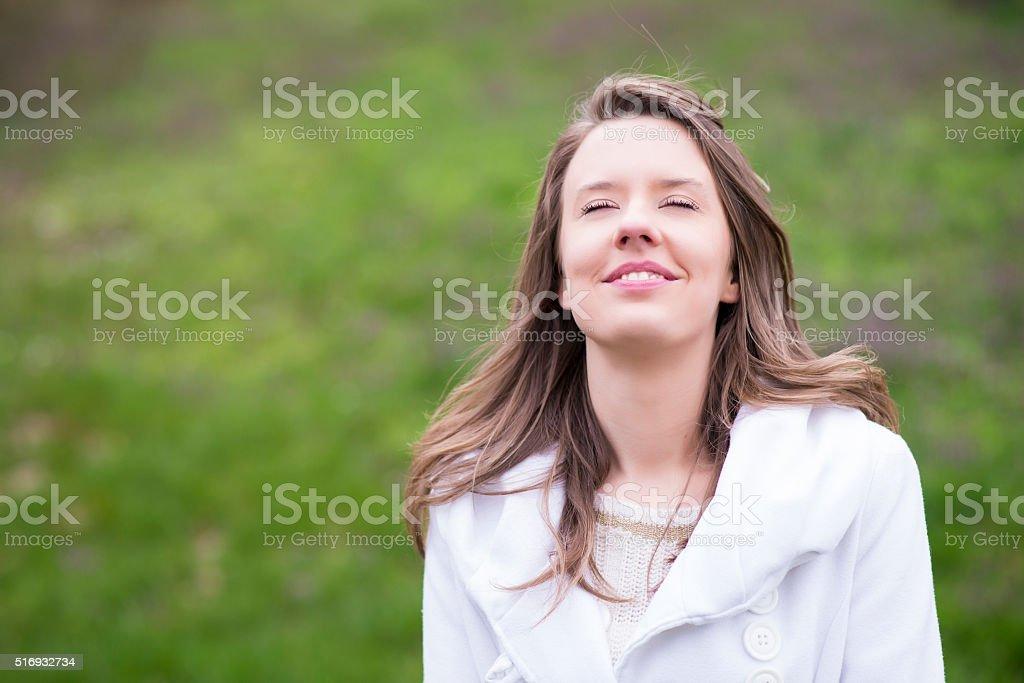 Smiling woman breathing deep fresh air stock photo