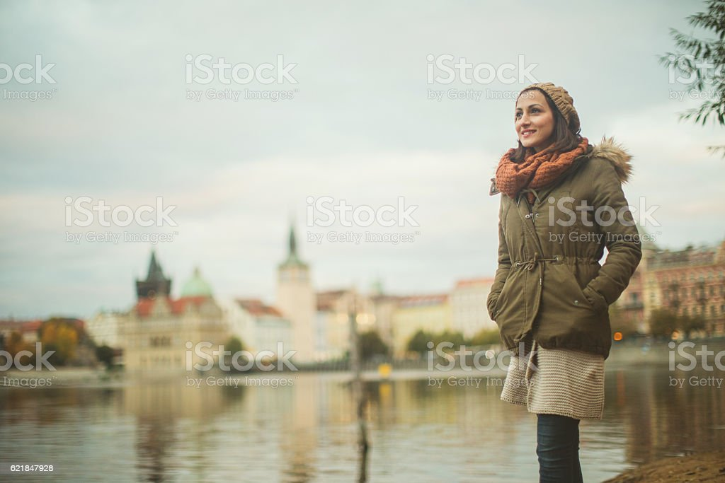 Smiling woman by the river stock photo