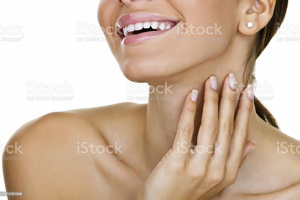 Smiling woman caressing her skin stock photo