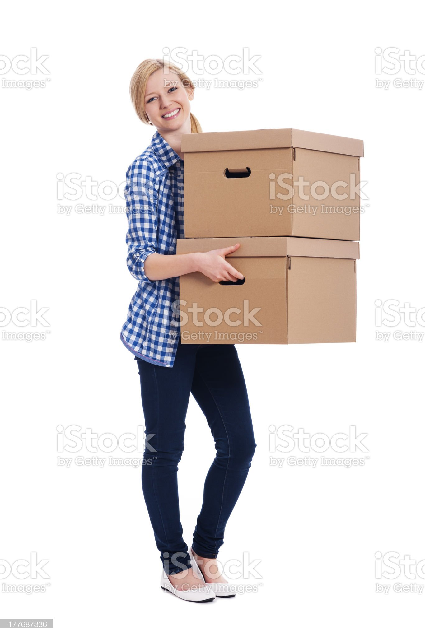 Smiling woman carrying two boxes royalty-free stock photo
