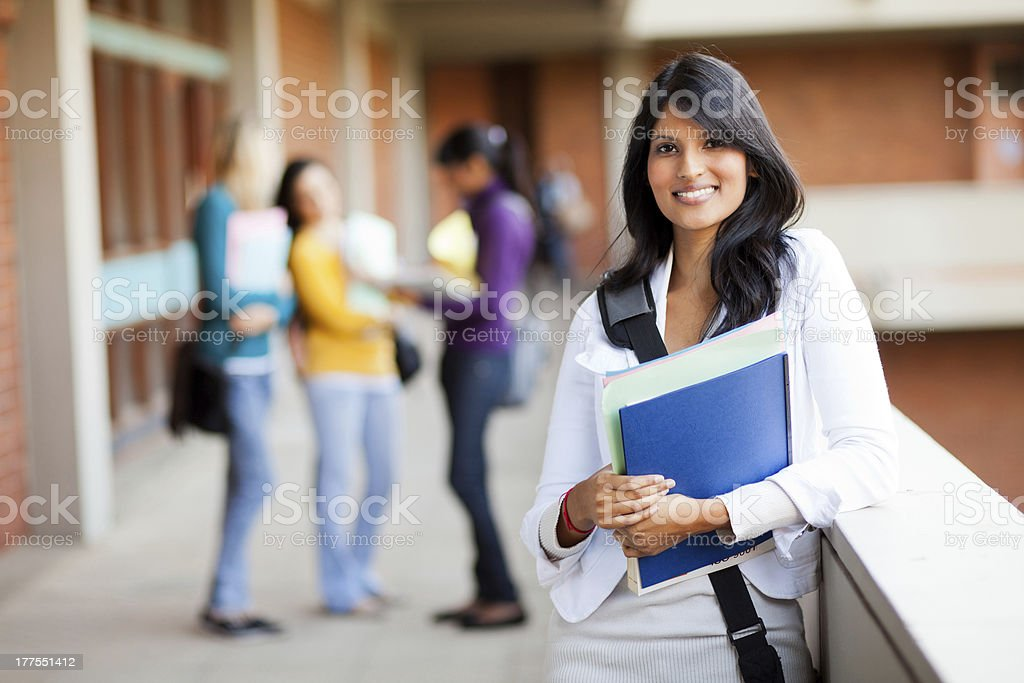 Smiling woman college student holding folders stock photo
