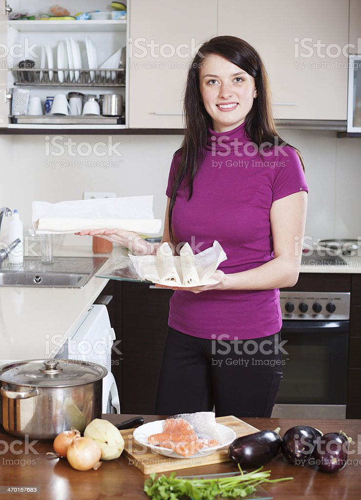 Smiling woman cooking fish pie stock photo