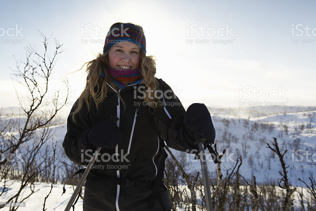 Smiling woman cross-country skiing stock photo