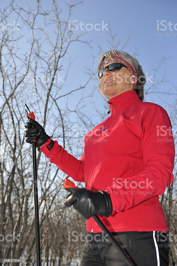 Smiling woman, cross-country skiing, winter sport royalty-free stock photo