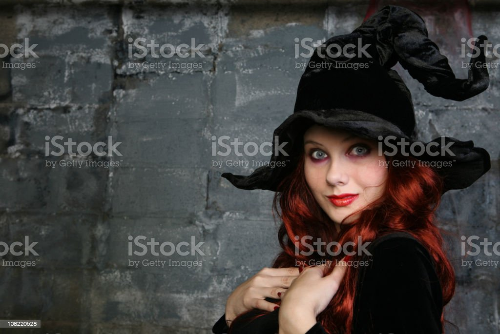 Smiling Woman Dressed as Witch stock photo