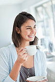 Smiling woman drinking coffee