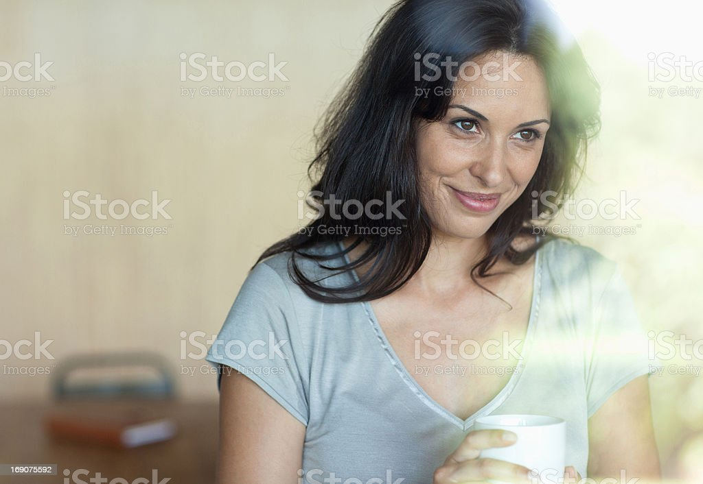 Smiling woman drinking coffee royalty-free stock photo