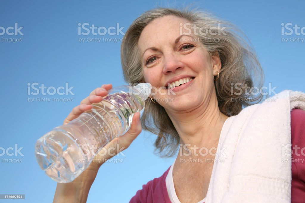 Smiling Woman Drinking Water royalty-free stock photo
