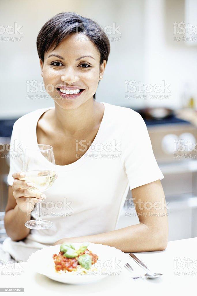 Smiling woman eating salad royalty-free stock photo