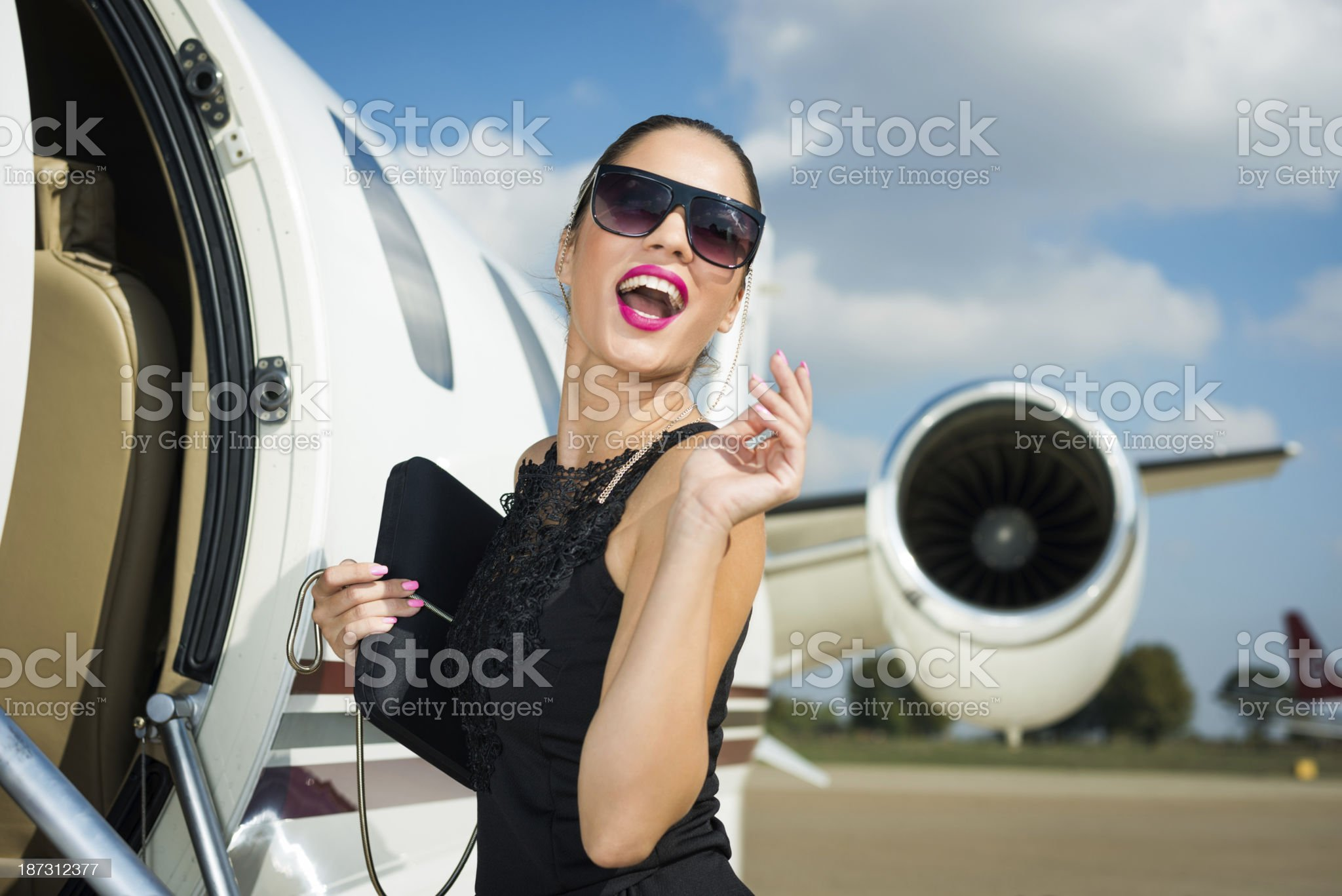 Smiling woman entering the airplane royalty-free stock photo