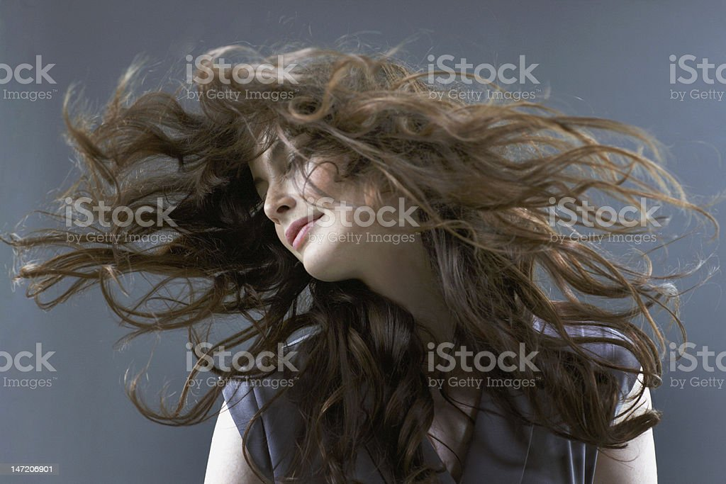 Smiling woman flipping hair stock photo