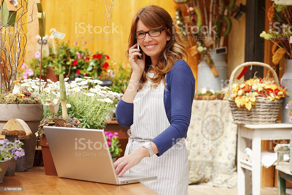 Smiling Woman Florist, Small Business Flower Shop Owner stock photo