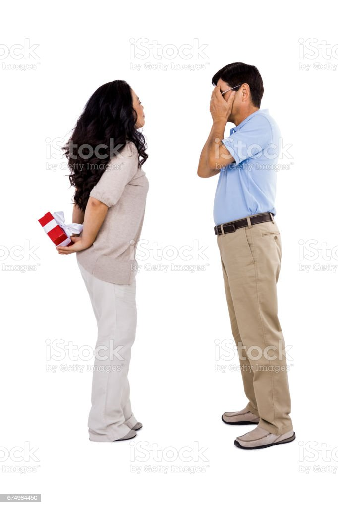 Smiling woman giving her partner a present stock photo