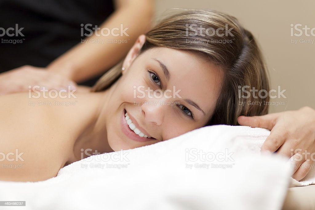 Smiling woman having a massage stock photo
