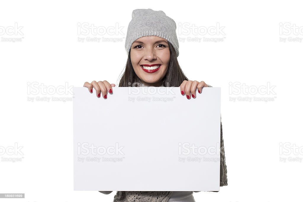 Smiling woman holding a blank sign royalty-free stock photo