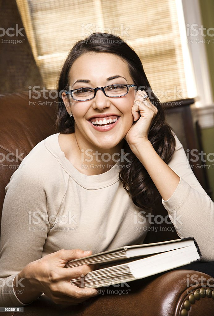 Smiling woman holding a book. royalty-free stock photo