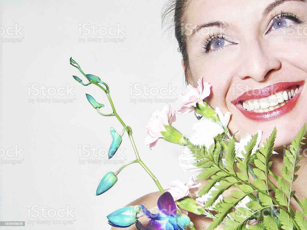Smiling woman holding a bouquet royalty-free stock photo