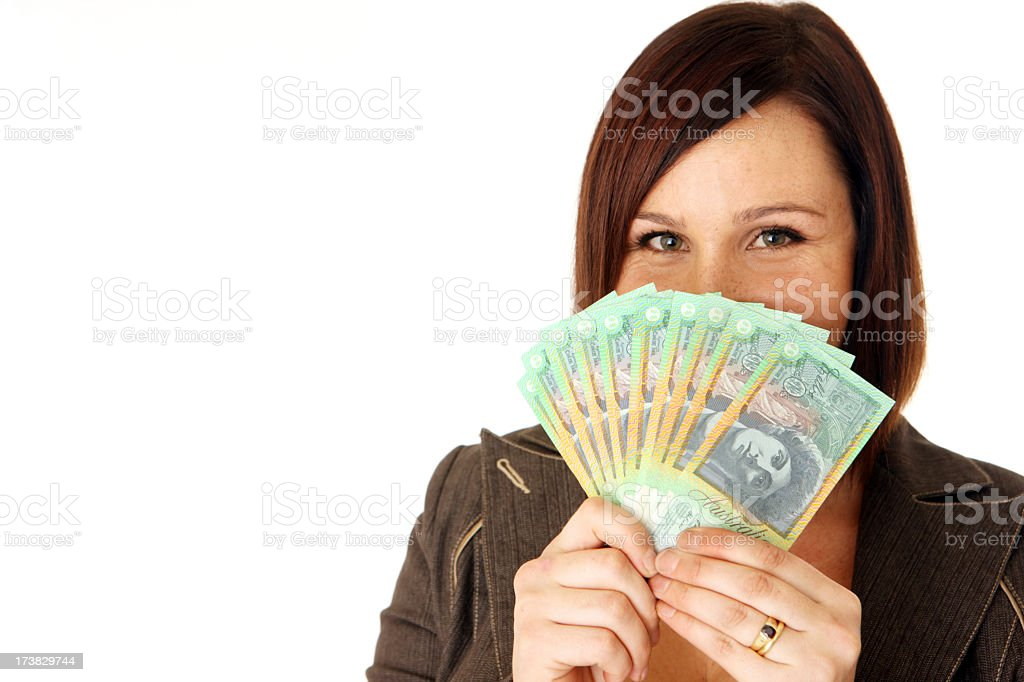 Smiling woman holding a bundle of Australian banknotes stock photo