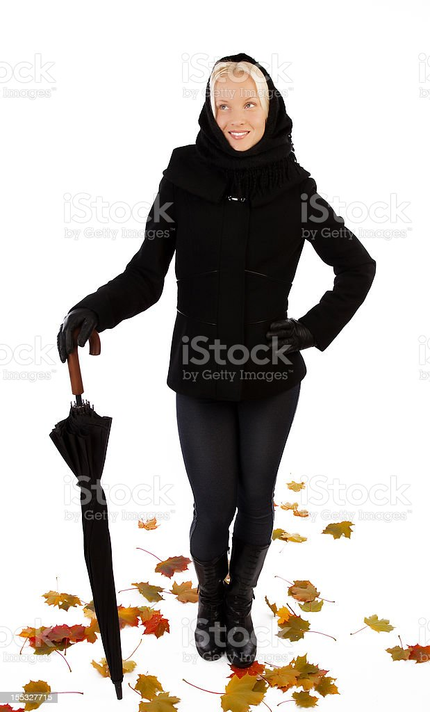 Smiling woman holding an umbrella royalty-free stock photo