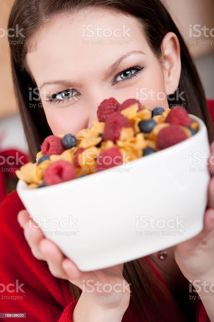 Smiling woman holding bowl of cereal royalty-free stock photo