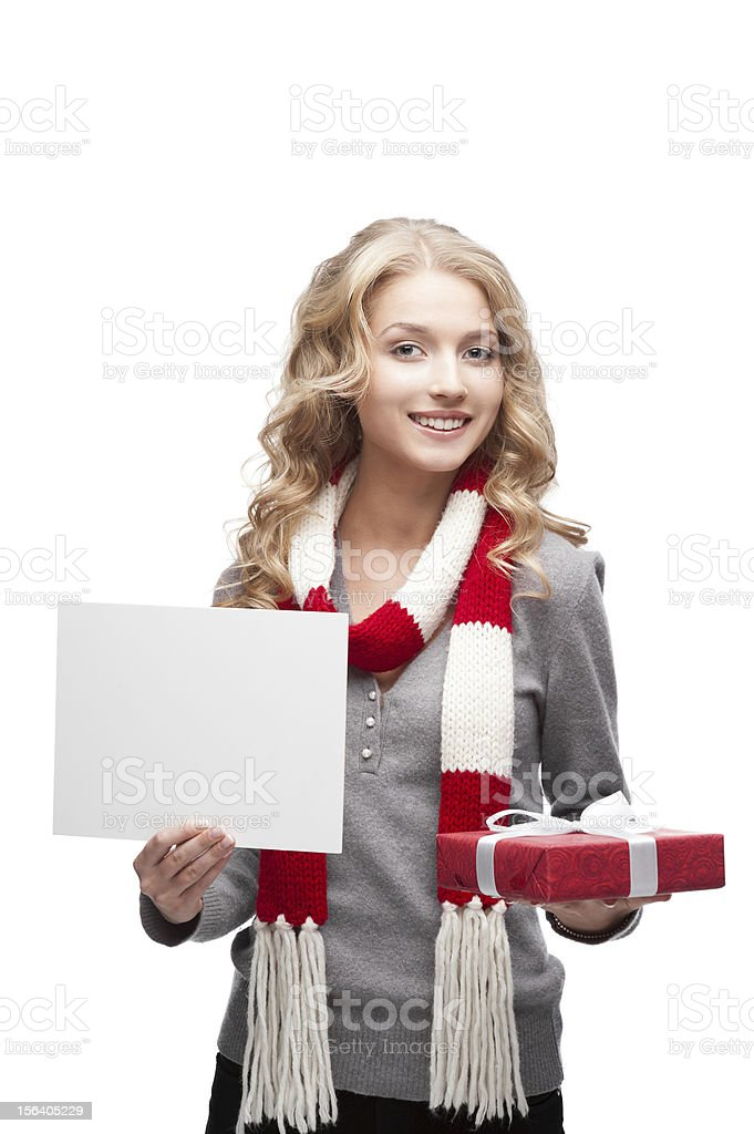 smiling woman holding christmas gift and sign royalty-free stock photo