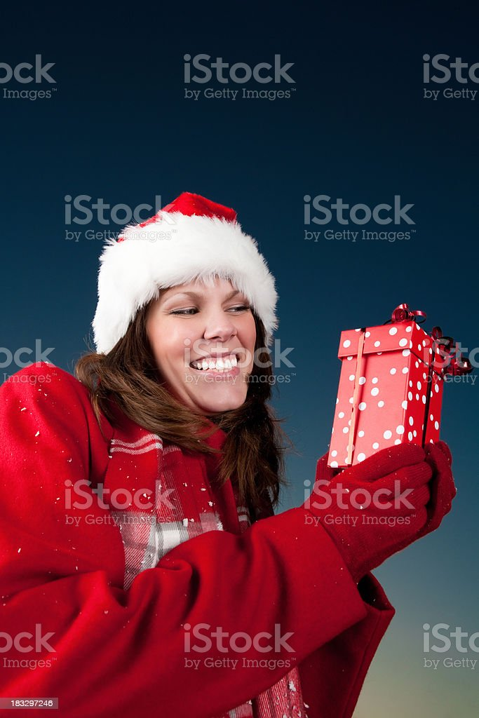 Smiling woman holding christmas present royalty-free stock photo