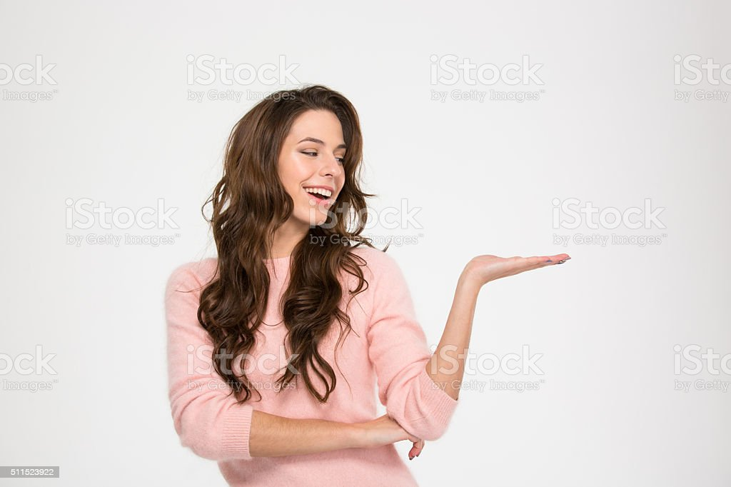 Smiling woman holding copyspace on the palm stock photo