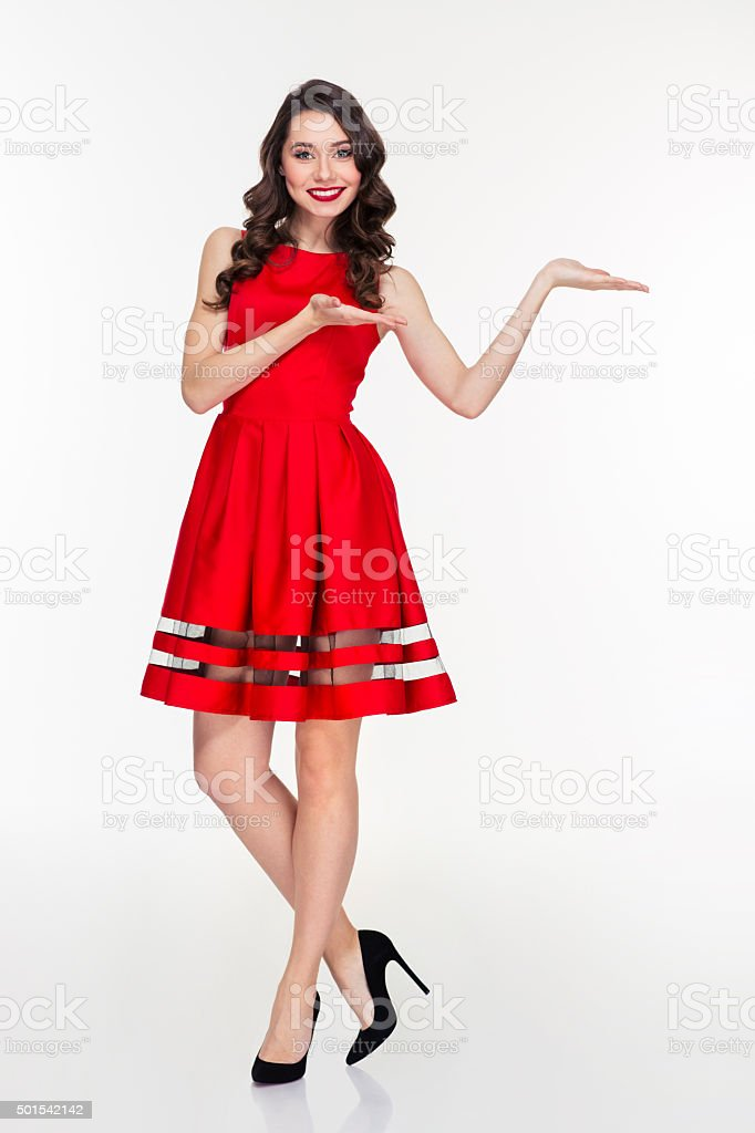 Smiling woman holding copyspace on the palms stock photo