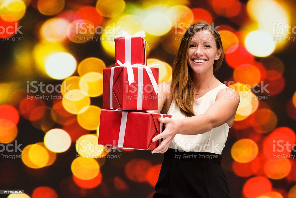 Smiling woman holding gift box stock photo