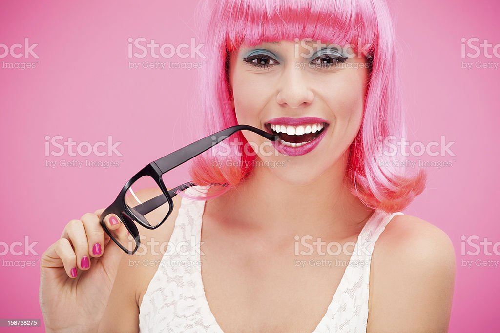 Smiling woman holding glasses royalty-free stock photo