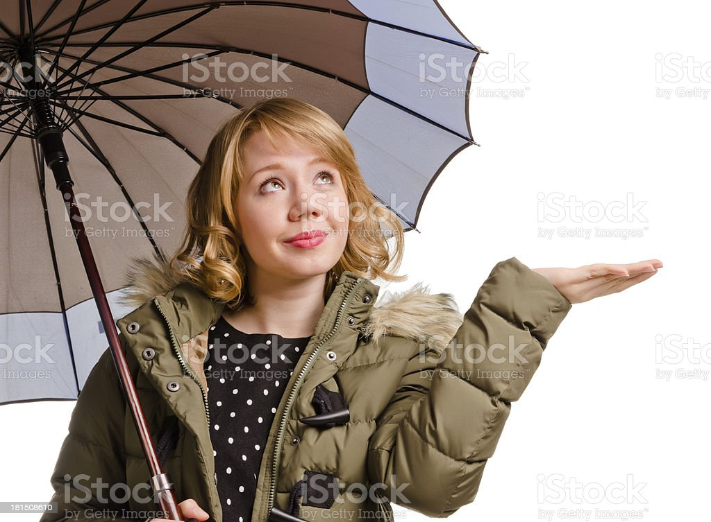 Smiling woman holding out her hand for rain royalty-free stock photo
