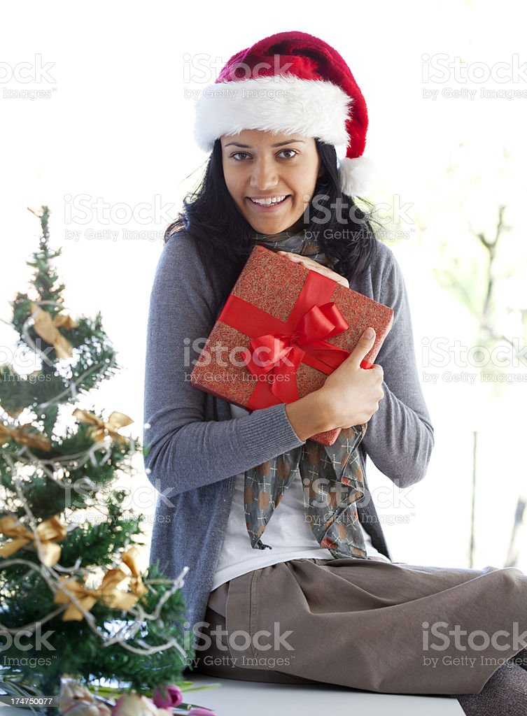 smiling woman holding present royalty-free stock photo