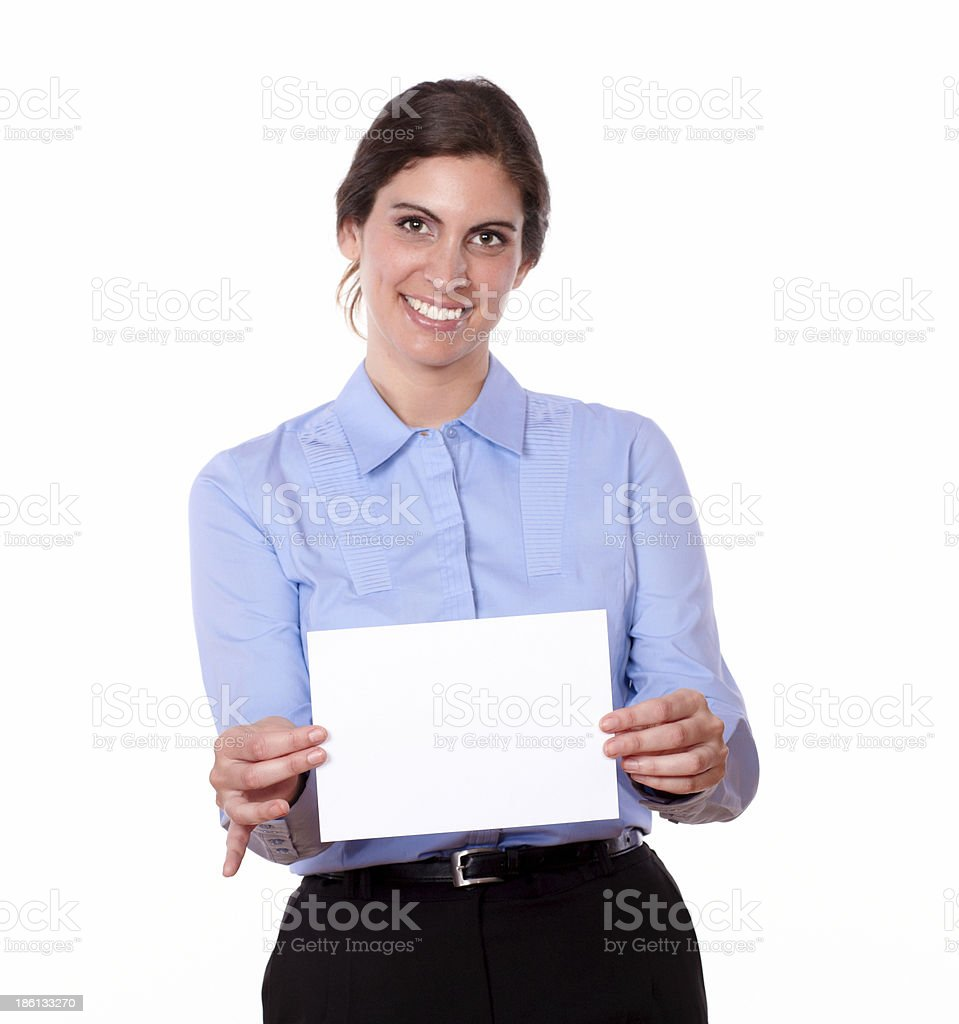 Smiling woman holding up a blank white card royalty-free stock photo