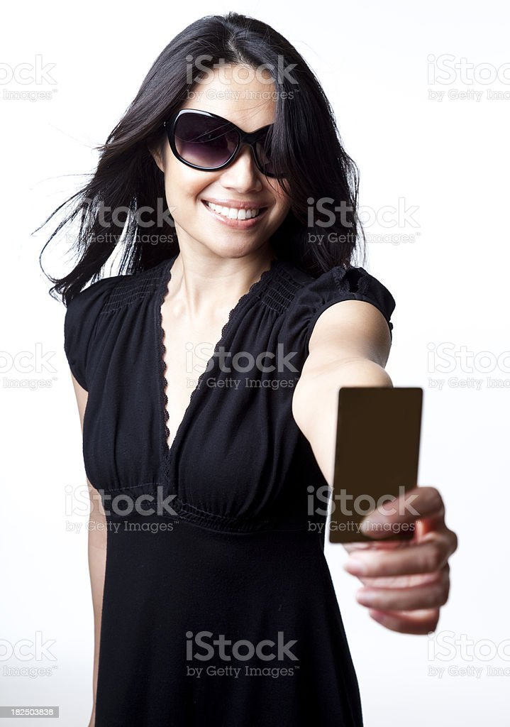 smiling woman holding up credit  card to the camera royalty-free stock photo