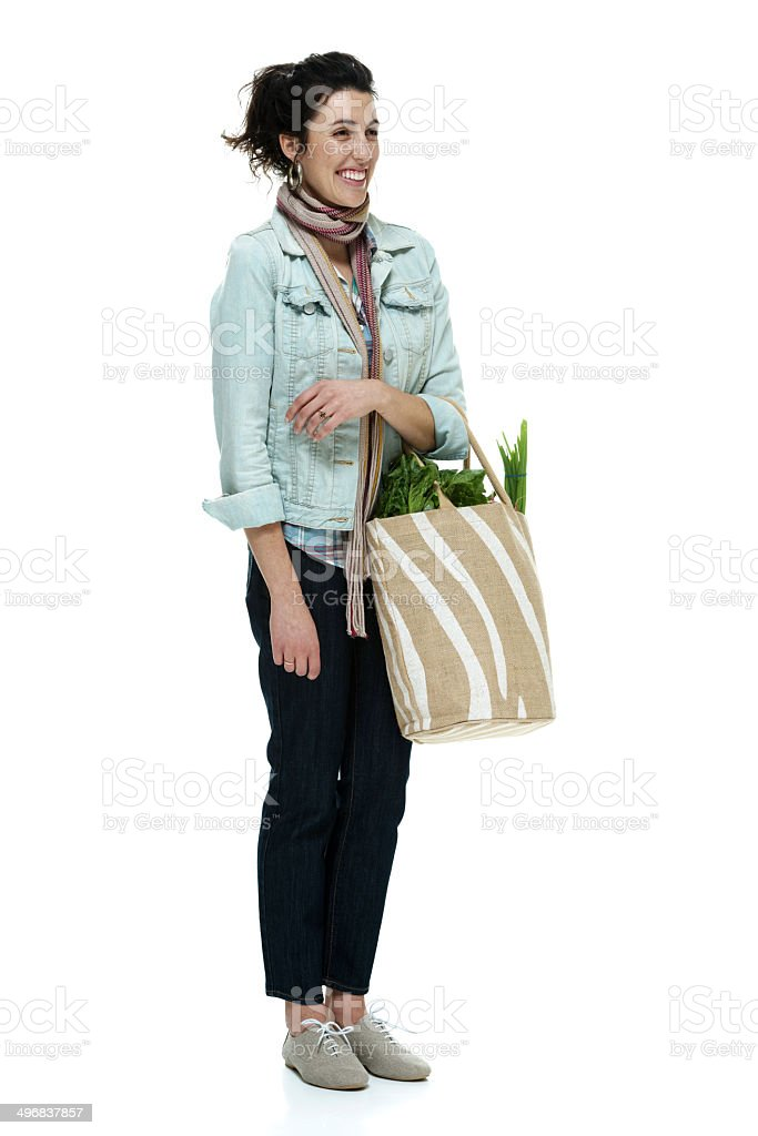 Smiling woman holding vegetable bag royalty-free stock photo