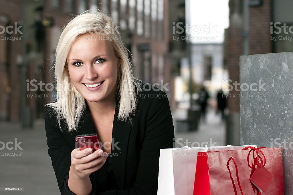 Smiling woman holds a smart phone royalty-free stock photo