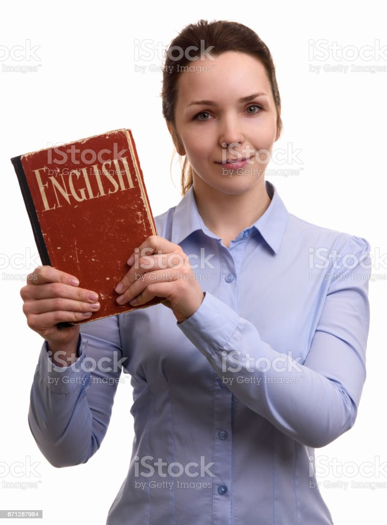 smiling woman holds an english textbook stock photo