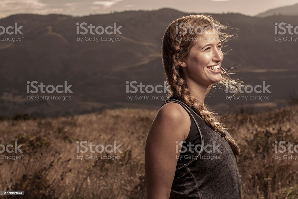 Smiling Woman in a Beautiful Outdoor Setting stock photo