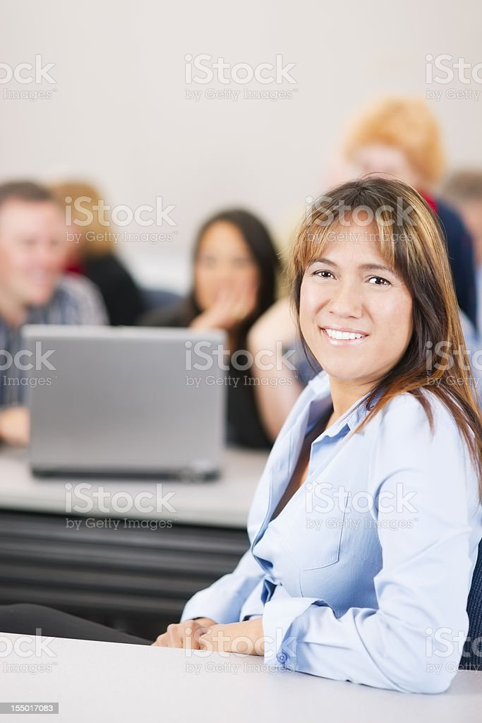 Smiling woman in a classroom royalty-free stock photo