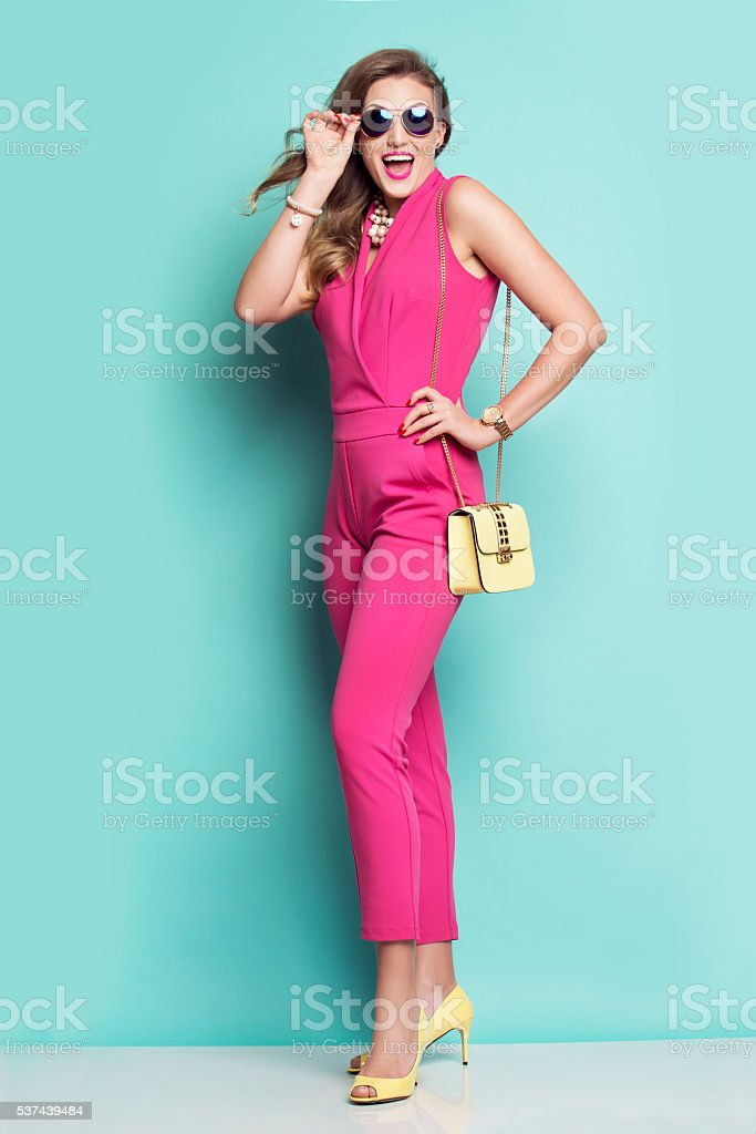 Smiling woman in a pink outfit stock photo