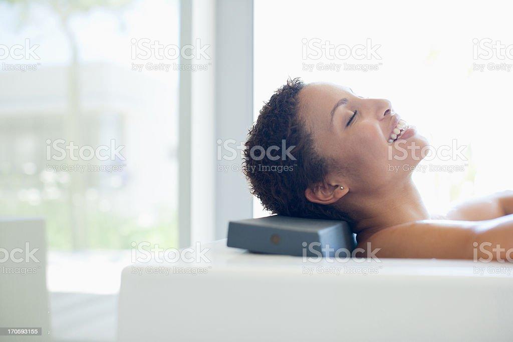 Smiling woman in bathtub royalty-free stock photo