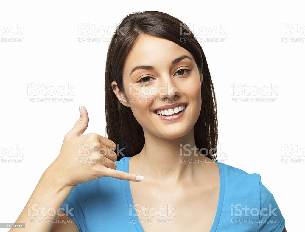 Smiling woman in blue shirt with call me hand gesture stock photo