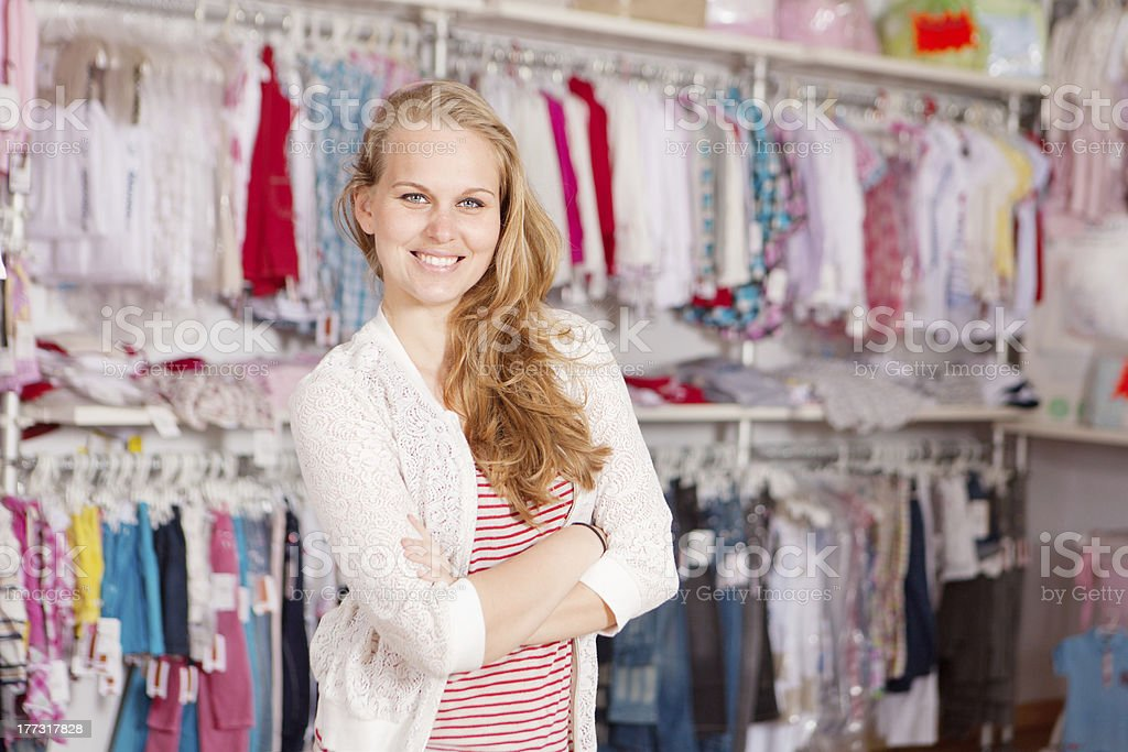 Smiling woman in clothing store stock photo