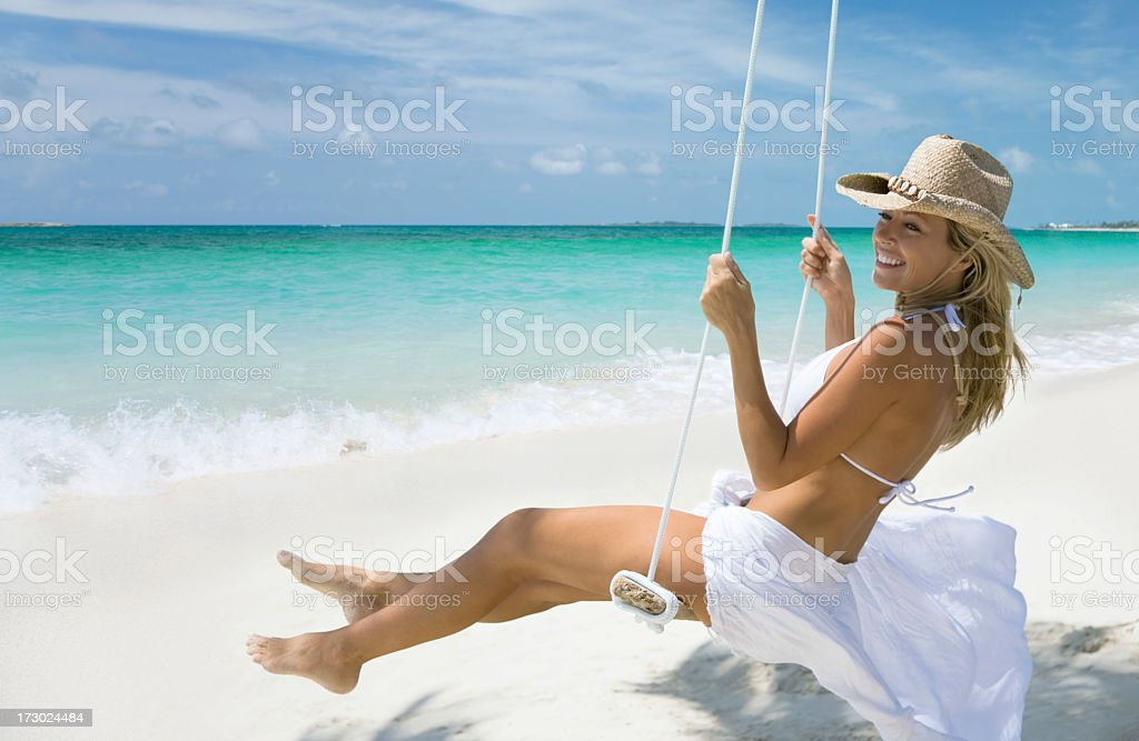 Smiling woman in cowboy hat on a swing royalty-free stock photo