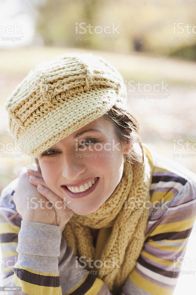 Smiling woman in knit cap and scarf stock photo