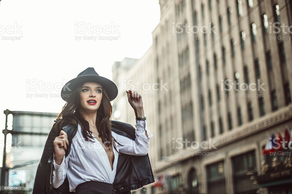 Smiling woman in leather jacket stock photo