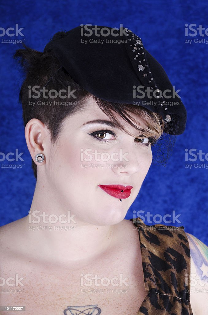 Smiling woman in navy and rhinestone 40s style hat. royalty-free stock photo